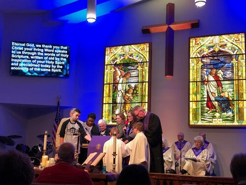Area Bishop, Sandra Steiner Ball and congregation members dedicate the pulpit.